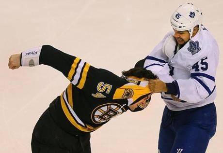 The Bruins' Adam McQuaid fought with Toronto's Mark Fraser in the first period on March 7.
